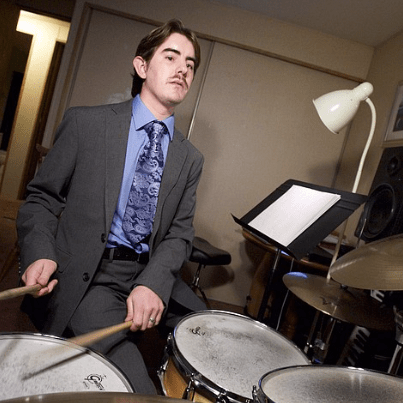 Blind-deaf drummer beats physical hurdles